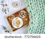 cup with cappuccino  doughnutt  ... | Shutterstock . vector #772706623