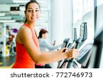 young fit woman using an... | Shutterstock . vector #772746973