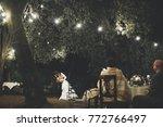 groom hugs bride tender while...   Shutterstock . vector #772766497