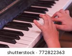 child plays old piano his hands ... | Shutterstock . vector #772822363