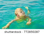 boy swims in the blue tropical... | Shutterstock . vector #772850287