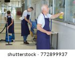 team cleaning a corridor | Shutterstock . vector #772899937