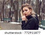 winter walk with cute blonde | Shutterstock . vector #772911877