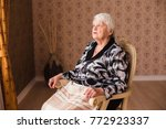 alone old woman sitting in a...   Shutterstock . vector #772923337