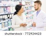 professional pharmacist helping ... | Shutterstock . vector #772924423