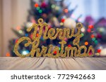 a wooden table with a gleaming...   Shutterstock . vector #772942663