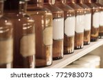 Small photo of Glass bottles filled with chemicals - Vintage apothecary
