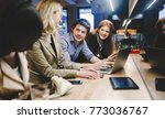 coworkers bonding in pub | Shutterstock . vector #773036767