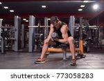 one young man  dark gym indoors ...   Shutterstock . vector #773058283