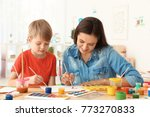 cute boy with mother painting... | Shutterstock . vector #773270833