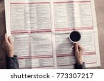 reading newspaper and drinking... | Shutterstock . vector #773307217