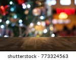 empty wood table top and blur... | Shutterstock . vector #773324563