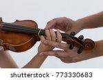 woman's hands help kid's hand... | Shutterstock . vector #773330683