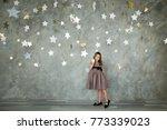 portrait of a happy little girl ... | Shutterstock . vector #773339023