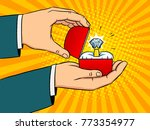 hands with precious diamond... | Shutterstock .eps vector #773354977