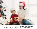 christmas preparations mother... | Shutterstock . vector #773410273
