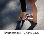 girl on the street takes off... | Shutterstock . vector #773432323