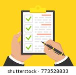 hand with black pen and... | Shutterstock .eps vector #773528833