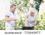 elderly marriage grilling meat... | Shutterstock . vector #773543977