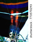 Small photo of Burner of a hot air balloon with fire. A bright flame for preparing to launch a huge flying airship.
