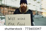 portrait of young homeless man... | Shutterstock . vector #773603347