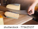 cutting parmesan  hard cheese ... | Shutterstock . vector #773625157