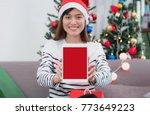 Woman Wear Santa Hat Holding...