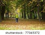 nordic walking woman in vibrant ... | Shutterstock . vector #77365372