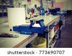 long workbench in a mechanical... | Shutterstock . vector #773690707