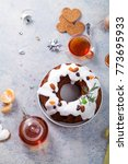 Small photo of Traditional christmas cake with dried fruits soaked in rum and sugar glaze. Teatime with heart-shaped ginger cookies. Christmas background with festive decoration. Copy space.