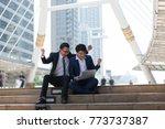 asian two businessman happy... | Shutterstock . vector #773737387