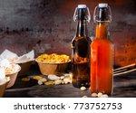 various beer snacks in plates... | Shutterstock . vector #773752753