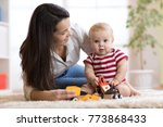 happy mother playing with baby... | Shutterstock . vector #773868433