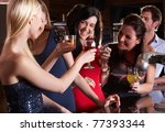 young women drinking at bar | Shutterstock . vector #77393344