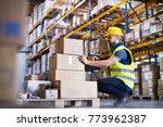 male warehouse worker with... | Shutterstock . vector #773962387