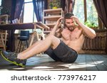 side view of young male doing... | Shutterstock . vector #773976217