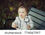 smiling baby girl sdending time ... | Shutterstock . vector #774067597
