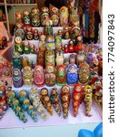 Small photo of Russian dolls in market, all sizes all colors