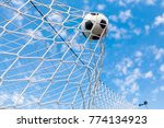 a soccer ball in a net | Shutterstock . vector #774134923