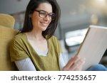 brunette woman with eyeglasses... | Shutterstock . vector #774253657
