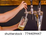 close up of a barman hand at... | Shutterstock . vector #774409447