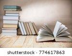 open textbooks on wood desk... | Shutterstock . vector #774617863