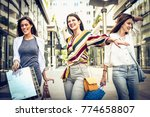 happy young women in city with... | Shutterstock . vector #774658807