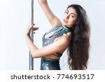 pole dancer. girl posing near... | Shutterstock . vector #774693517