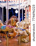 Small photo of Colourful carousel horses