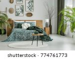 stool on white round carpet in... | Shutterstock . vector #774761773