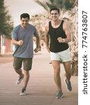 smiling sportsmen are jogging... | Shutterstock . vector #774763807