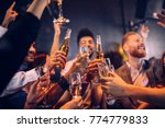 group of friends cheering with... | Shutterstock . vector #774779833