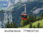 a red cable car in a swiss alps ... | Shutterstock . vector #774823723