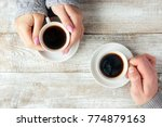 cups with a coffee in the hands ...   Shutterstock . vector #774879163